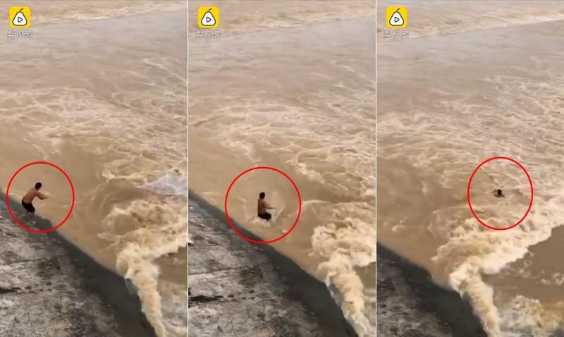 """洪災實拍:男子""""拿命捕魚"""" 6秒遭洪水吞沒(視頻)"""