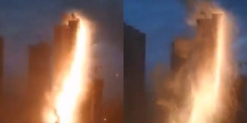 惊人瞬间:辽宁暴雨 闪电把楼给劈了!